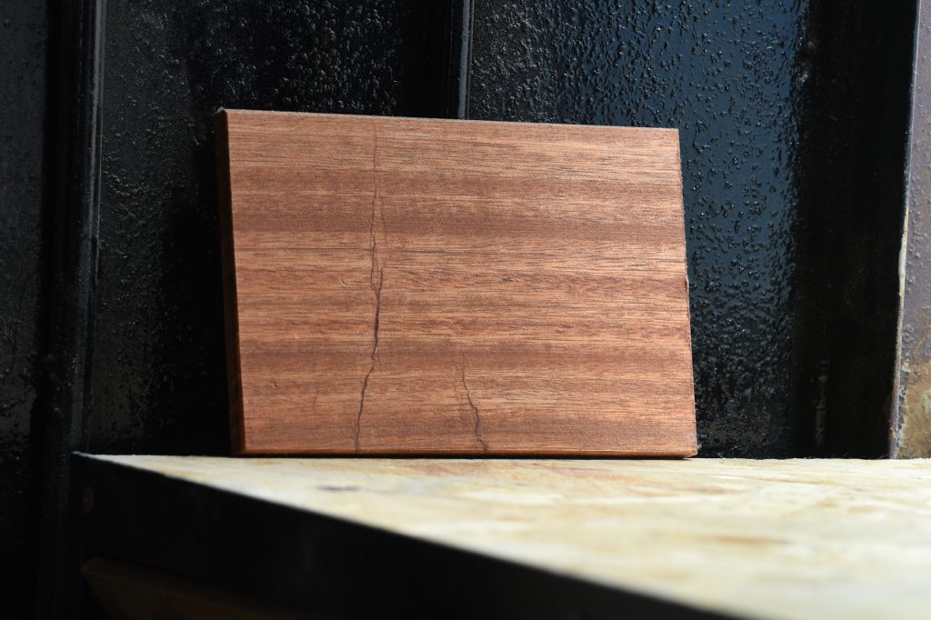 Swatch of Acajou wood used for custom furniture