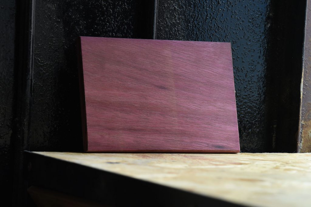 Swatch of Purpleheart wood used for custom furniture