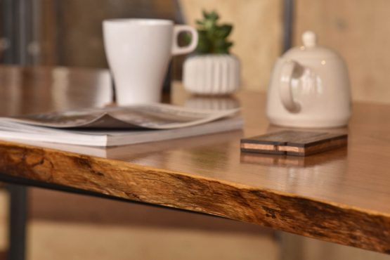 Oak live-edge slab custom made dining table in hong kong with teapot, mug and magazine