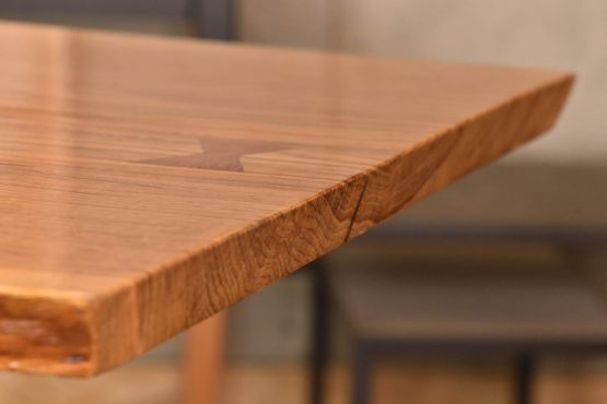 Oak live edge table detail with 'bowties' Nakashima Style