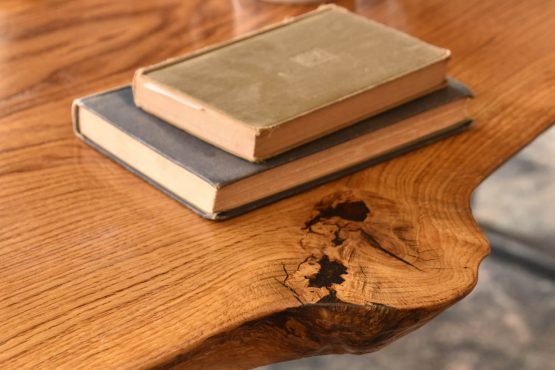 Detail of a knot in oak with two antique books genuine and custom