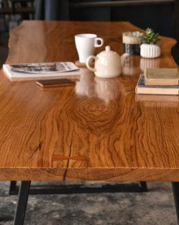 Long shot of Oak live edge table showing large dark grain patterns for morning breakfast