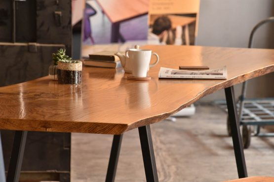 morning dining room table with magazine and books in indirect lighting custom oak table with hong kong made steel legs
