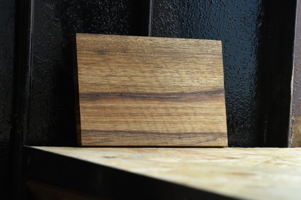 Swatch of Tigerwood used for custom furniture