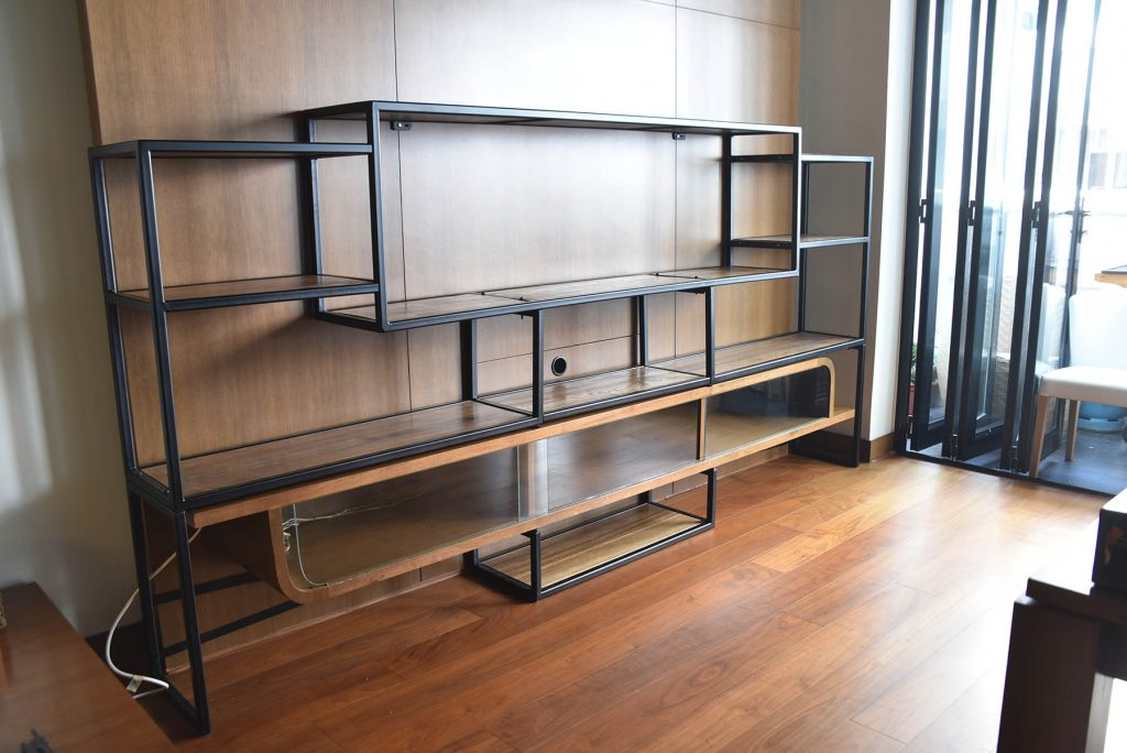 Stylish custom furniture built in Hong Kong by craftspeople in elm wood and black steel
