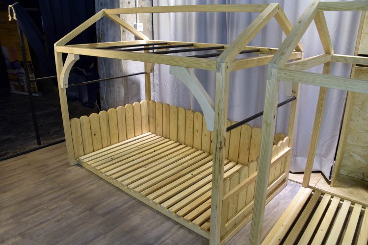 Stylish custom furniture built in Hong Kong by craftspeople in pine and black steel childrens bed