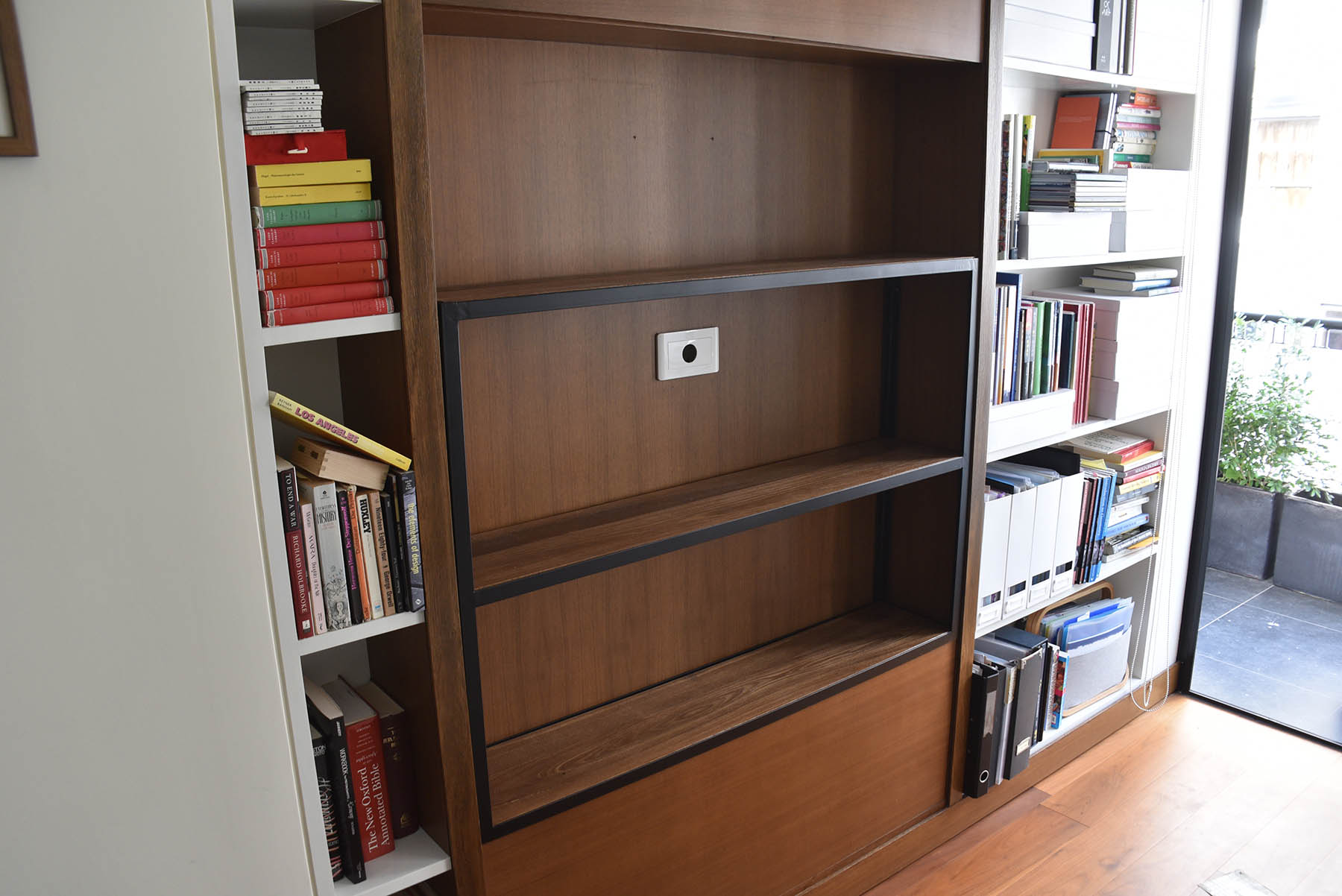 Stylish custom made furniture built in Hong Kong by craftspeople in Elm wood and black steel